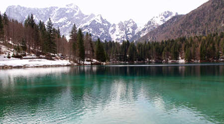 clear water: Fantastic Alpine Lake with crystal clear water and the mountains in the background 2