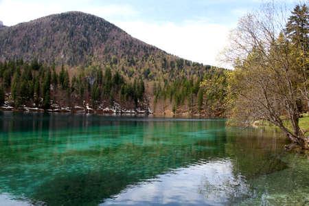 clear water: Fantastic Alpine Lake with crystal clear water and the mountains in the background 3 Stock Photo
