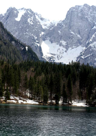 clear water: Fantastic Alpine Lake with clear water and the mountains in the background 4
