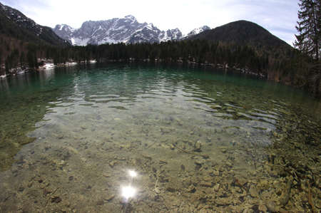 Clear water of the Lake with the Alps with fisheye lens 2