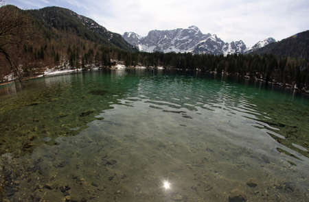clear water: Clear water of the Lake with the Alps in the background with fisheye lens 1
