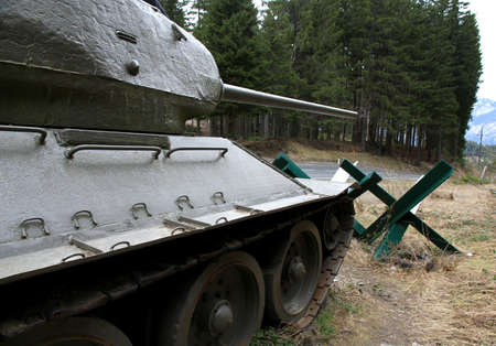 green camouflage tank used during the war in defense Stock Photo - 27851190