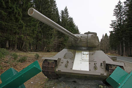 green camouflage tank used during the war in defense of the roadblock