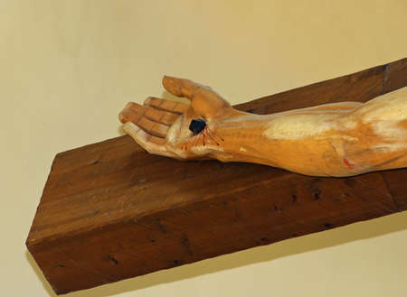 hand nailed to the wood of the cross of Jesus Christ photo