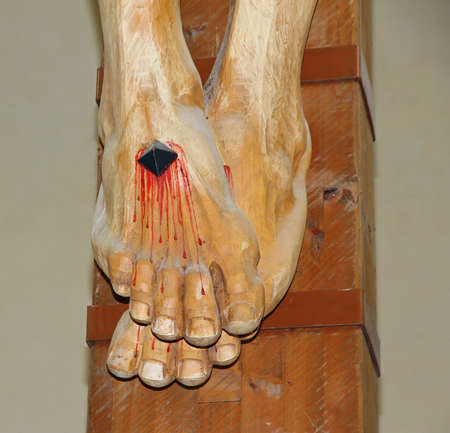 stigmata: Jesus Christs feet with the nail and blood coming out