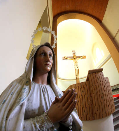 our lady of sorrows: Statue of our Lady of sorrows and the great crucifix in the background