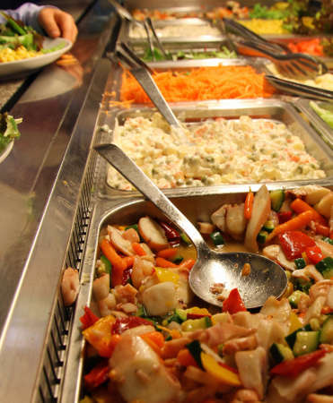 large steel trays with many delicious foods in a self-service restaurant 2