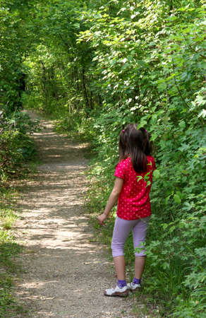 young little GIRL lost in the Woods trail waiting for MOM Stock Photo