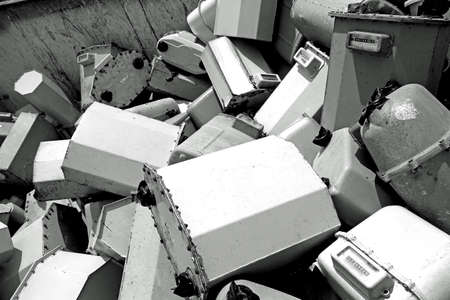junky: piles of old disused gas counters in a special waste landfill  piles of old disused gas counters in a special waste landfill