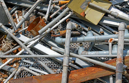 junky: Rusty pipe and more iron and metal material in a landfill of metallic material