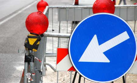 roadwork: large white arrow of roadwork during an excavation in roadway