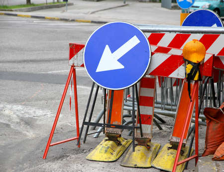 roadwork: many road signs with a large arrow to identify the place of work in progress Stock Photo
