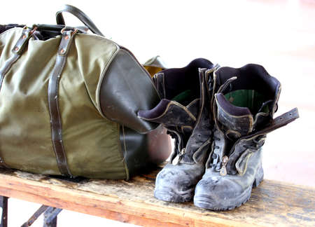 work boots and bag for the transport of clothes after a strenuous working day photo