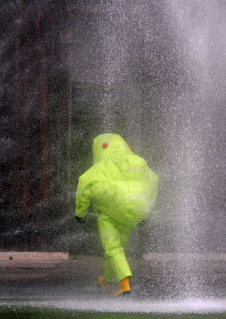 spray of water toward the person with the suit during an evacuation from biohazard photo
