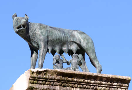 lupa: The she-wolf nursing twins while founders of Rome with blue sky background