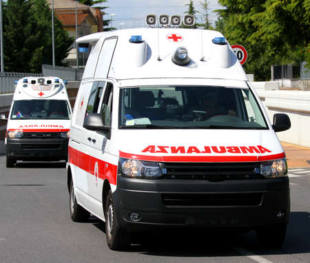 sirens: Two italian ambulances in the street run fast to the place of accident