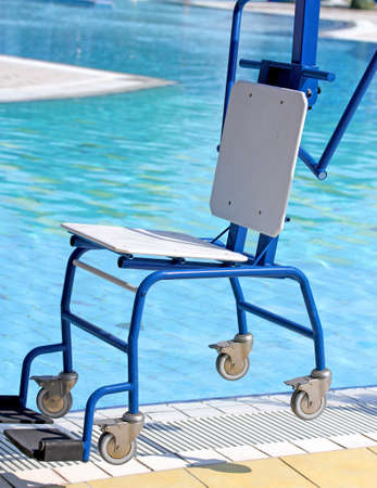 ingenious: Ingenious blue Chair for disabled people to make use of the pool for the handicapped Stock Photo