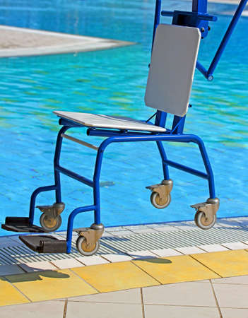 dystrophy: Rugged wheelchairs for disabled people near the pool