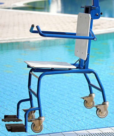 blu Chair for disabled people to make use of the pool for the handicapped photo