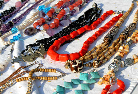red necklaces with other necklaces for sale in the vintage shop photo