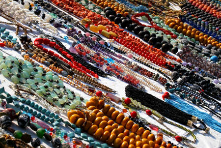 necklaces illuminated by the Sun necklace for sale at flea market stall photo