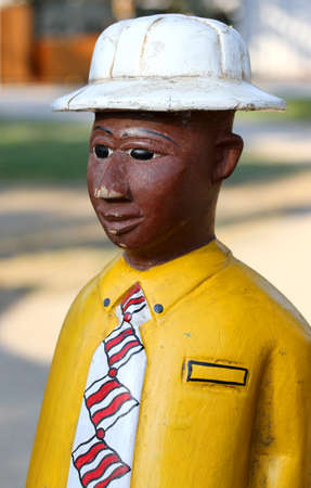 lovely African statue of a man with the White Cap and the very elegant dress Stok Fotoğraf