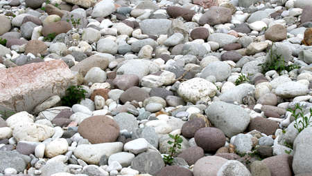 tapered and rounded pebbles on the shore of the great river in Northern Italy Reklamní fotografie
