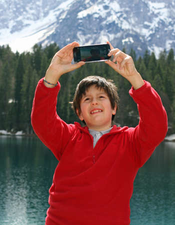 digitization: smiling baby while doing a selfie  with new smartphone