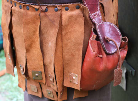 barter system: old leather bag for storing the money and coins in the middle ages