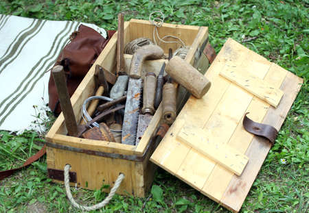 basket with antique rust working tools for carpenters and Farriers photo