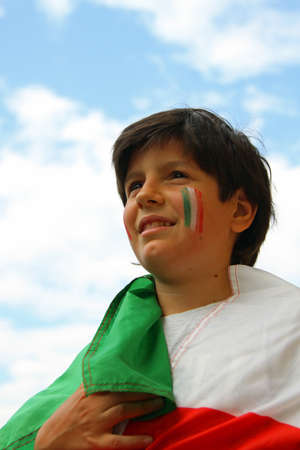 Young pretty boy with painted flag  photo