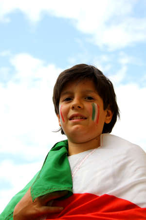 italian boy with painted flag before the football match