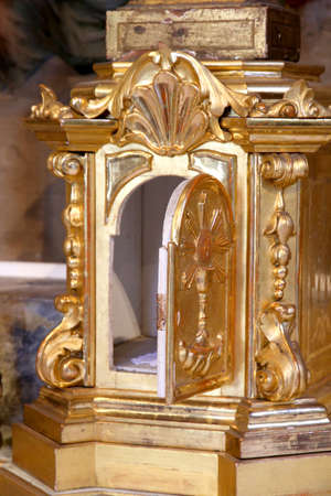 tabernacle: precious gold Tabernacle with door open in a Christian Church