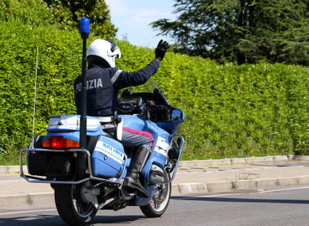 patrolman: Italian police motorbike patrolman with high hand