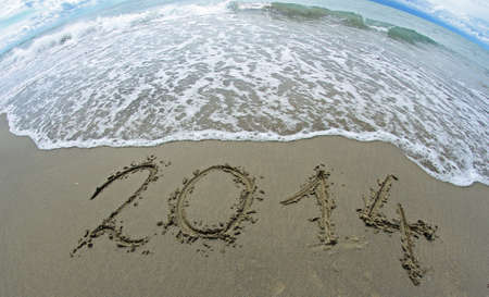 wave that erases 2014 year written on the sea beach with fisheye lens 1 photo