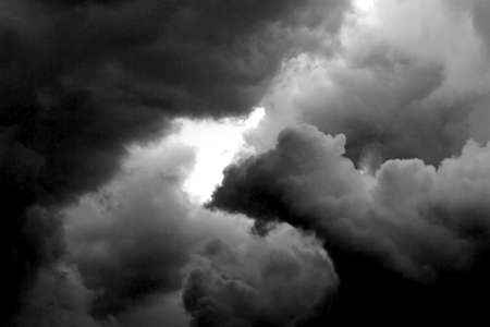 dreary: very dark very cloudy weather the storm prepares and a little hole in the sky Stock Photo