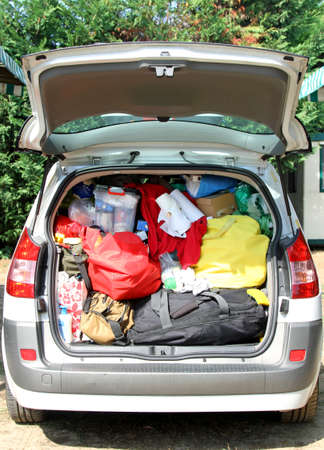 duffle: suitcases and bags in the trunk of the car before leaving after the holidays