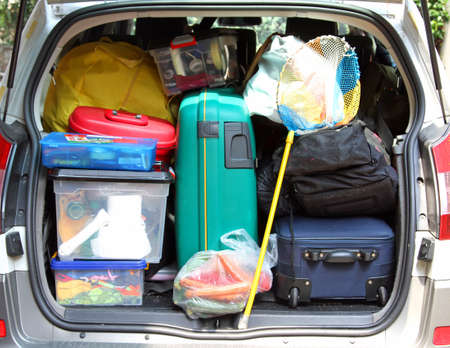 large suitcase in the trunk of the car for family vacations photo