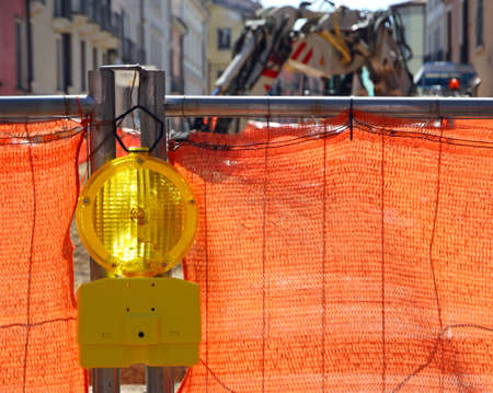 roadworks: signal lamp yellow and Orange network in roadworks in the city