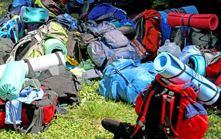 knapsacks: colorful pile of knapsacks of boy Scouts during an excursion in the nature park