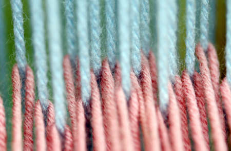 rug weaving: wires blue and pink wool for rug weaving in ancient Manual loom