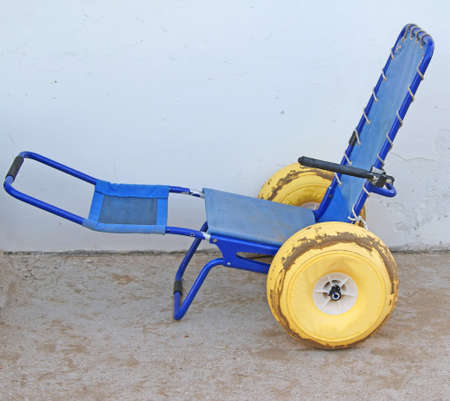 ingenious: ingenious wheel chair with wheels with rubber tires to go in the sea