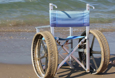 ingenious: ingenious wheelchair with stainless steel wheels to enter in to the sea