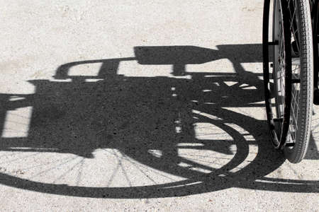 shadow of the wheelchair and the detail of the tyre Stock Photo