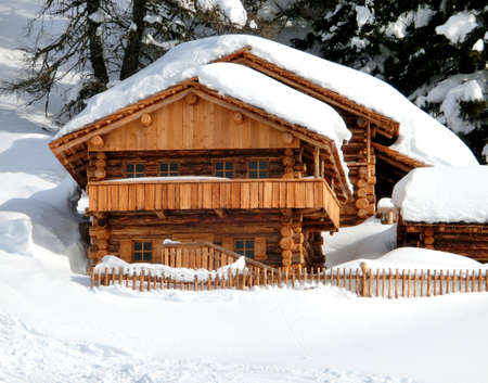 little chalet in the mountain with white snow
