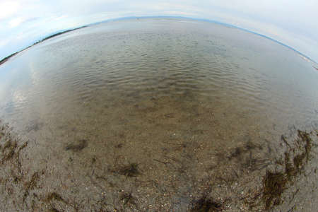 the sea and the beach with fisheye lens in summer Banco de Imagens