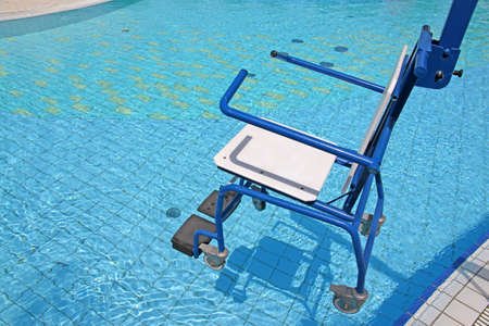 wheelchair for the disabled for use in swimming pool photo