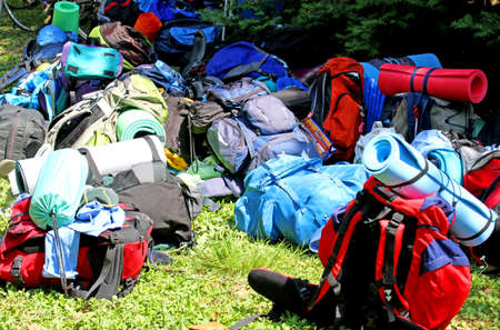 knapsacks: colorful pile of knapsacks of Scouts during an excursion in the nature park