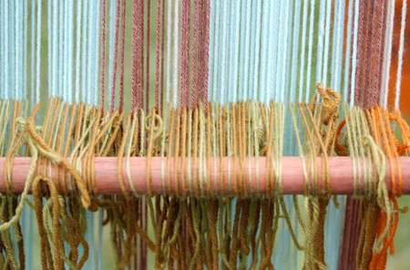 thesis: row of colored wool thesis in ancient textiles weaving loom