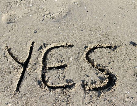 great written YES engraved on the sand of the Sea Beach Stock Photo - 30502601